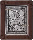 Серебряная икона размером 10х12 см в деревянной рамке