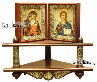 Вид полки иконной с иконами в киотах